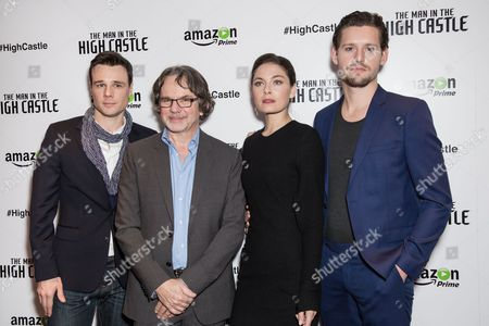 """From left, Rupert Evans, Frank Spotnitz, Alex Davalos and Luke Kleintank pose for photographers during a photo call for the television series """"The Man in the High Castle"""" in London"""