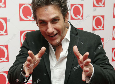 Comedian Tom Stade arrives on the red carpet for the 2013 Q Awards, at a central London hotel
