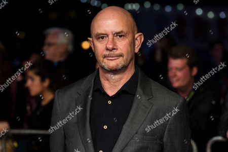 Author Nick Hornby poses for photographers on arrival at the premiere of the film 'Their Finest', showing as part of the London Film Festival in London
