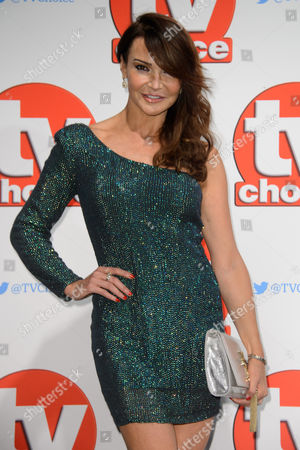 Lizzy Cundy poses for photographers at the TV Choice Awards 2015 at a central London venue, London