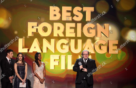 """Stefan Arndt accepts the award for best foreign language film for """"Amour"""" at the 18th Annual Critics' Choice Movie Awards at the Barker Hangar, in Santa Monica, Calif"""