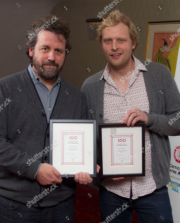Dominic Dromgoole, left and Tom Bird hold the Shakespeare Globe Special Awards following the Critics' Circle Theatre Awards at the Prince of Wales Theatre in London