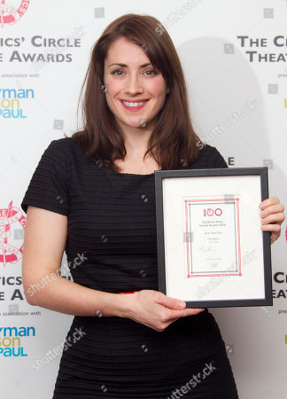 Britsh Playwright Lucy Prebble holds the award for Best New Play following the Critics' Circle Theatre Awards at the Prince of Wales Theatre in London
