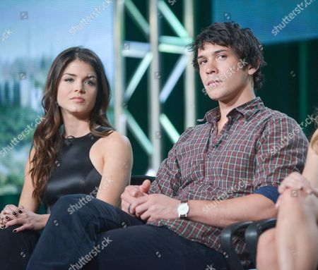 """Marie Avgeropulos, left, and Bob Morley participate in the """"The 100"""" panel discussion at the CW Winter 2014 TCA Press Tour, Wed, in Pasadena, Calif"""
