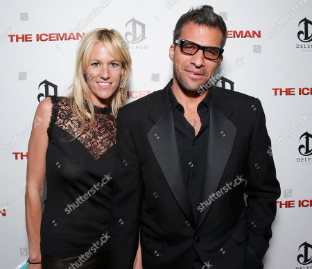 Stock Image of Writer Morgan Land, right, and guest attend the DeLeon Tequila special screening of The Iceman at the Arclight on in Los Angeles