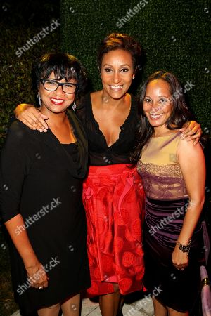 "AMPAS president Cheryl Boone Isaacs, left, Desiree Rogers, center, and Toni Thompson attend the ""House of Flowers"" dinner honoring Diahann Carol and Boone Isaacs at the home of Tracey Edmonds on in Beverly Hills, Calif"