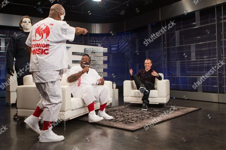 From left, Tech N9ne, Krizz Kaliko, and host DJ Skee film a segment of SKEE Live on in Los Angeles