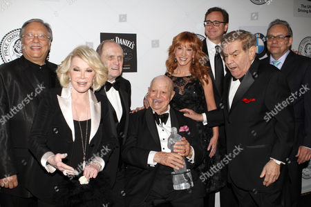 Musician Arturo Sandoval, left, Comedian Joan Rivers, Comedian Bob Newhart, Honoree Don RIckles, Comedian Kathy Griffin, Actor Bob Saget, Friars Clubs Dean Freddie Roman and Comedian Lewis Black pose for photos at the Friars Club Roast in his honor at the Waldorf Astoria on in New York
