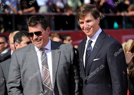 Stock Picture of Mark Schlereth, left, and New York Giants quarterback Eli Manning arrive at the ESPY Awards, in Los Angeles