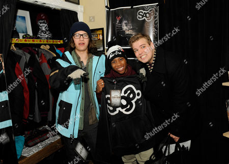From left, actors Dillon Lane, Carlon Jeffery and Andrew Caldwell visit the Saga Outerwear booth at the Fender Music lodge during the Sundance Film Festival, in Park City, Utah