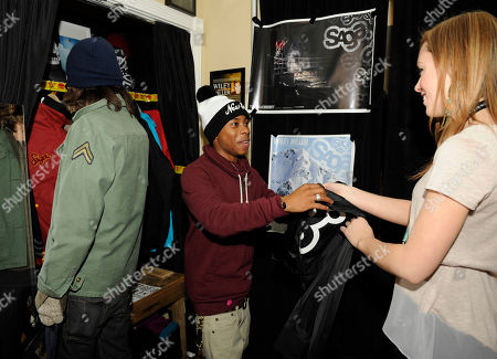 From left, actors Dillon Lane and Carlon Jeffery visit the Saga Outerwear booth at the Fender Music lodge during the Sundance Film Festival, in Park City, Utah
