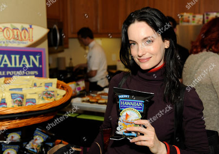Actress Alex Lombard visit the Tim's Cascade Snacks Hawaiian Kettle Style Potato Chips at the Fender Music lodge during the Sundance Film Festival, in Park City, Utah