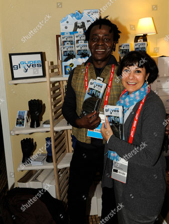 Director John Akomfrah, left, and producer Lina Gopaul visit the Glider Gloves booth at the Fender Music lodge during the Sundance Film Festival, in Park City, Utah