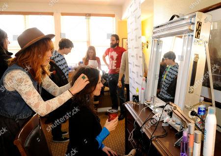 Producer Liz Garcia visits the Keratin Complex pop-up salon at the Fender Music lodge during the Sundance Film Festival, in Park City, Utah