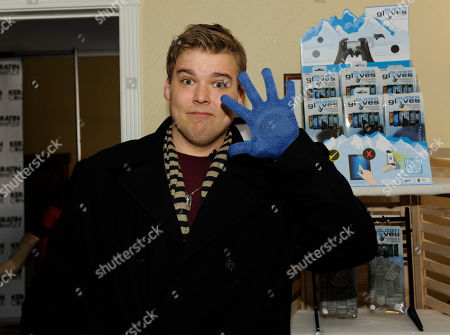 Stock Image of Actor Andrew Caldwell visits the Glider Gloves booth at the Fender Music lodge during the Sundance Film Festival, in Park City, Utah
