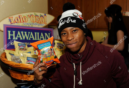 Actor Carlon Jeffery visits the Tim's Cascade Snacks Hawaiian Kettle Style Potato Chips booth at the Fender Music lodge during the Sundance Film Festival, in Park City, Utah