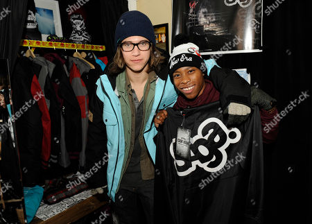 Actors Dillon Lane, left, and Carlon Jeffery visit the Saga Outerwear booth at the Fender Music lodge during the Sundance Film Festival, in Park City, Utah