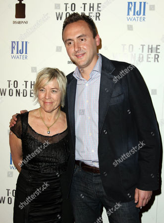 """Producers Sarah Green, left, and Nicolas Gonda arrive at the premiere of """"To The Wonder"""" hosted by FIJI Water on in Los Angeles"""