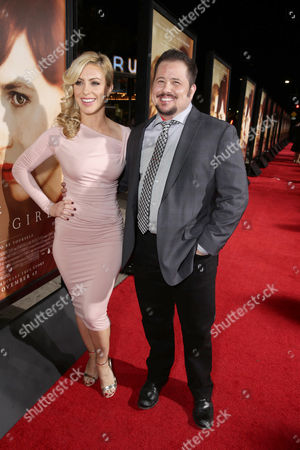 Chaz Bono and guest seen at Focus Features Los Angeles premiere of 'The Danish Girl' at Regency Village Theatre, in Los Angeles, CA