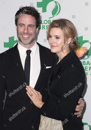 Matthew Cooke, left, and Maggie Grace arrive at the Global Green USA's 12th Annual Pre-Oscar Party at the Avalon Hollywood, in Los Angeles