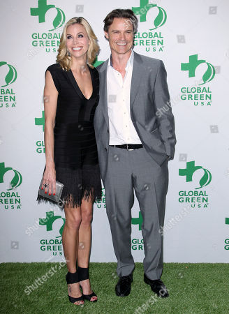 Brooke Burns, left, and Dylan Neal arrive at the Global Green USA's 12th Annual Pre-Oscar Party at the Avalon Hollywood, in Los Angeles