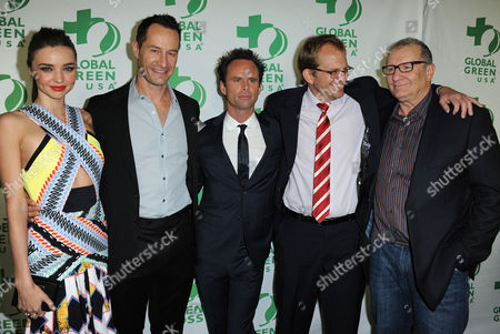 From left, model Miranda Kerr, Global Green Co-Founder Sebastian Copeland, actor Walton Goggins, Global Green CEO Matt Petersen, and actor Ed O'Neil arrive at Global Green USA's 10th Annual Pre-Oscar Party at the Avalon, on in Los Angeles