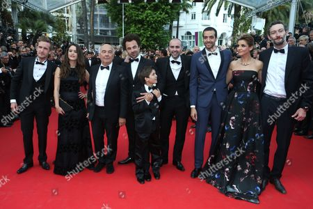 From left, Vincent Desagnat, Alice David, Gerard Jugnot, Philippe Lacheau, Nicolas Benamou, Enzo Tomasini, Clotilde Courau, Julien Arruti and Tarek Boudali on the red carpet for the screening of How To Train Your Dragon 2 at the 67th international film festival, Cannes, southern France