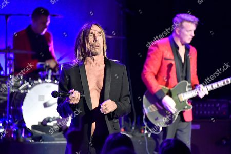 Matt Helders, from left, Iggy Pop, and Josh Homme perform during the Post Pop Depression tour at The Filmore, in Miami Beach, Fla
