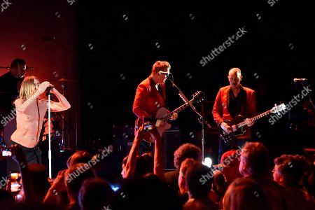 Matt Helders, from left, Iggy Pop, Josh Homme and Matt Sweeney perform during the Post Pop Depression tour at The Filmore, in Miami Beach, Fla