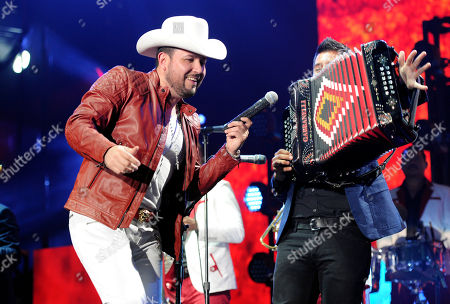 Roberto Tapia, left, performs with his band at the iHeart Radio Fiesta Latina concert at The Forum, in Inglewood, Calif