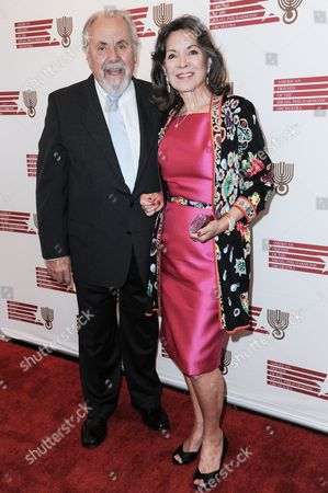 George Schlatter, left, and Jolene Brand arrive at the Israeli Philharmonic Orchestra Honors Hans Zimmer held at the Wallis Annenberg Center for the Performing Arts, in Beverly Hills, Calif