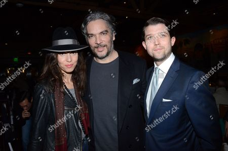 "Anissa Bonnefont, Andrea Di Stafano and Thomas Froyland pose at private LA dinner for ""Song One"" screening hosted by Jean Shafiroff with director Kate Barker-Froyland and Anne Hathaway at The Palm Restaurant, in Beverly Hills, California"
