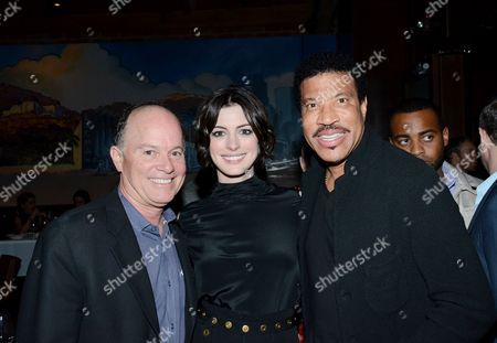 "Kevin Allyn, Anne Hathaway, and Lionel Richie pose at private LA dinner for ""Song One"" screening hosted by Jean Shafiroff with director Kate Barker-Froyland and Anne Hathaway at The Palm Restaurant, in Beverly Hills, California"