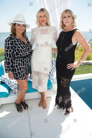Kathy Wakile, left, Kristen Taekman, middle, and Vicki Gunvalson attend Jill Zarin's 4th Annual Luxury Benefit Luncheon in Southampton, in New York