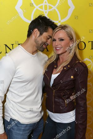 From left, Eddie Judge and Tamra Barney, from Real Housewives of Orange County, pose during the Luxe Party at the Kendra Scott Fashion Island Boutique, in Newport Beach, Calif