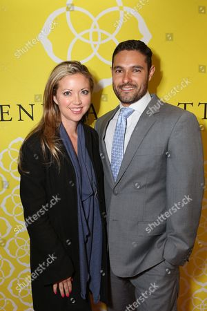 Stock Picture of From left, Jessica Castro and Jimmy Castro pose during the Luxe Party at the Kendra Scott Fashion Island Boutique, in Newport Beach, Calif