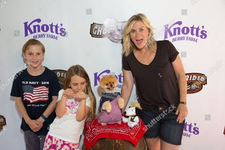 Alison Sweeney, right and children Benjamin Sanov and Megan Sanov pose with Jiffpom at the event to celebrate the return of the Ghostrider at Knott's Berry Farm, in Buena Park, Calif