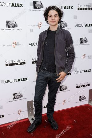 """Max Burkholder arrives at the LA Premiere of """"About Alex"""" held at the ArcLight Hollywood, in Los Angeles"""