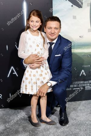 """Abigail Pniowsky, left, and Jeremy Renner arrive at the LA Premiere of """"Arrival"""" at the Regency Village Theatre, in Los Angeles"""