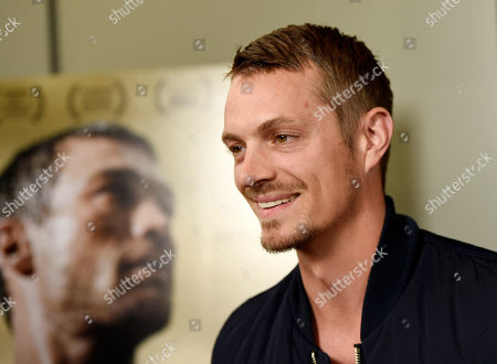 "Actor Joel Kinnaman poses at the premiere of the film ""Be Here Now (The Andy Whitfield Story),"" at the UTA Theater, in Beverly Hills, Calif"