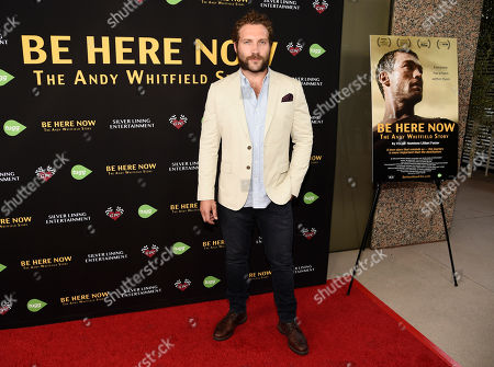 "Actor Jai Courtney poses at the premiere of the film ""Be Here Now (The Andy Whitfield Story),"" at the UTA Theater, in Beverly Hills, Calif. Whitfield died of non-Hodgkin lymphoma in 2011"