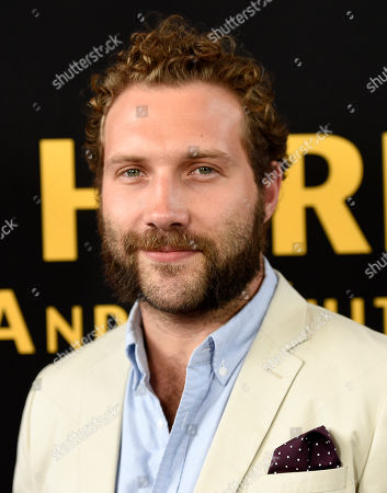 "Actor Jai Courtney poses at the premiere of the film ""Be Here Now (The Andy Whitfield Story),"" at the UTA Theater, in Beverly Hills, Calif"