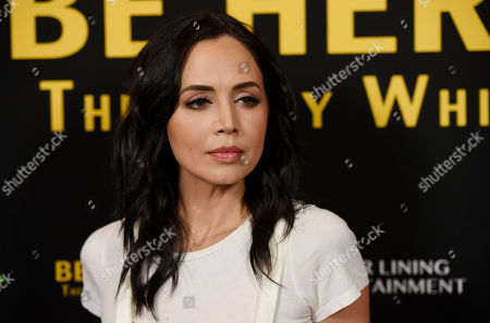"Actress Eliza Dushku poses at the premiere of the film ""Be Here Now (The Andy Whitfield Story),"" at the UTA Theater, in Beverly Hills, Calif"