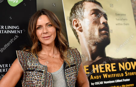 "Vashti Whitfield, widow of actor Andy Whitfield, poses at the premiere of the film ""Be Here Now (The Andy Whitfield Story),"" at the UTA Theater, in Beverly Hills, Calif. Whitfield died of non-Hodgkin lymphoma in 2011"