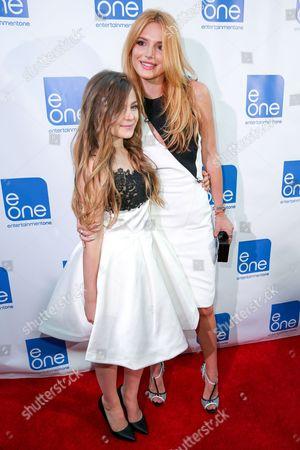 "Chiara Aurelia, left, and Bella Thorne arrives at the LA Premiere of ""Big Sky"" at the Arena Cinema, in Los Angeles"