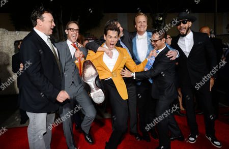 "Director/writer/producer Bobby Farrelly, and from left, producer Joey McFarland, Jim Carrey, director/writer/producer Peter Farrelly, Jeff Daniels, producer Riza Aziz and Swizz Beatz arrive at the premiere of ""Dumb and Dumber To"" at the Regency Village Theatre, in Los Angeles"