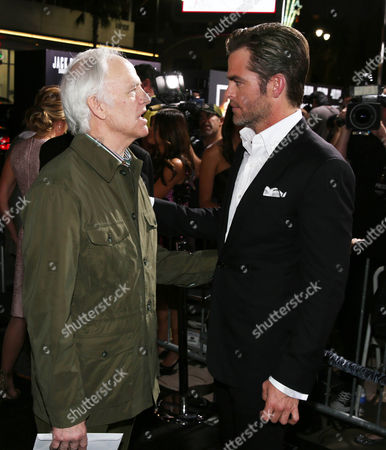 """Chris Pine, right, and Robert Pine talk to each other at the premiere of """"Jack Ryan: Shadow Recruit"""" in Los Angeles on"""