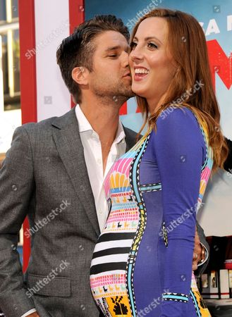 "Kyle Martino, left, kisses Eva Amurri Martino as they arrive at the Los Angeles premiere of ""Tammy"" at the TCL Chinese Theatre on"