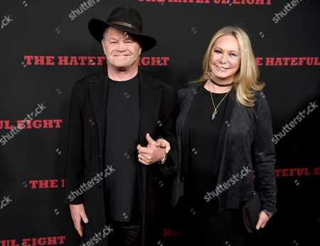 """Micky Dolenz, left, and Donna Quinter arrive at the Los Angeles premiere of """"The Hateful Eight"""" at the Cinerama Dome on"""