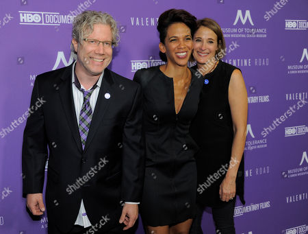 """Marta Cunningham, center, director of the documentary film """"Valentine Road,"""" poses with producers Eddie Schmidt, left, and Sasha Alpert at the premiere of the film at the Museum of Tolerance on in Los Angeles"""